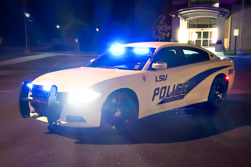 Photo of LSUE police car at night