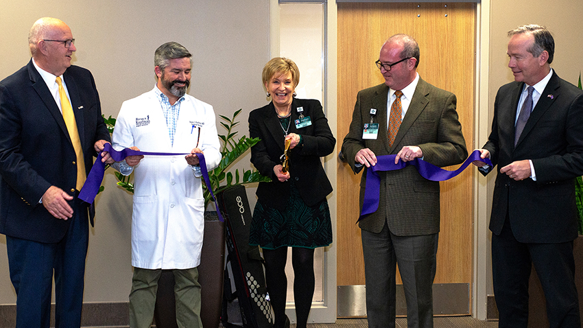 Photo of LGH and LSUE Staff cutting ribbon