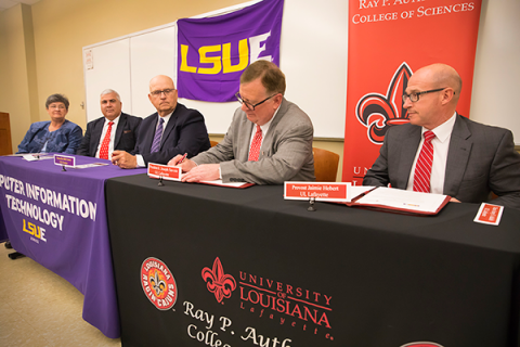 LSU and UL administrators sign paperwork